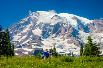 Wall Mural - Four children posing for the camera with Mt. Rainier in the background.