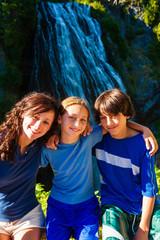Fototapete - Three children in front of Narada Falls in Mt. Rainier National Park.