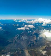 Mt. Ranier in Distance beyond snowy peaks