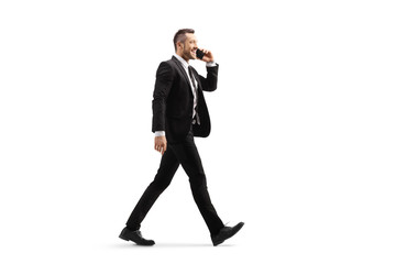 Businessman walking and talking on a mobile phone