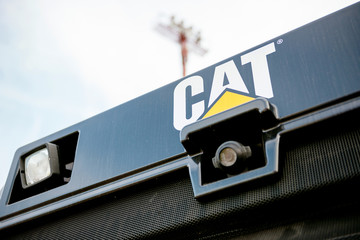 PARIS, FRANCE - SEP 5, 2014: Rear-view camera on the yellow bulldozer tractor constriction industrial machine with CAT Caterpillar logotype
