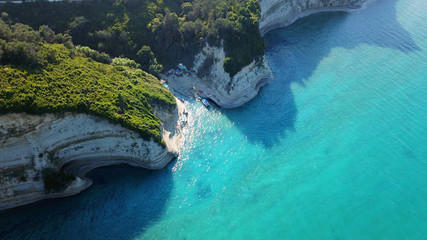Aerial drone photo of iconic white rock steep cliff volcanic bay of Cape Drastis and Peroulades area with tropical deep turquoise clear sea, Corfu island, Ionian, Greece Wall mural