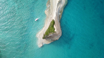 Aerial drone bird's eye view photo of iconic white rock volcanic tropical islet with emerald clear water sea