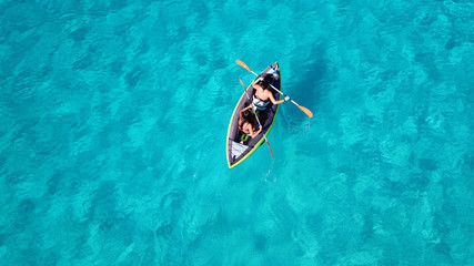 Foto auf AluDibond Sansibar Aerial drone photo of 2 women canoeing in tropical Caribbean exotic destination with turquoise sea