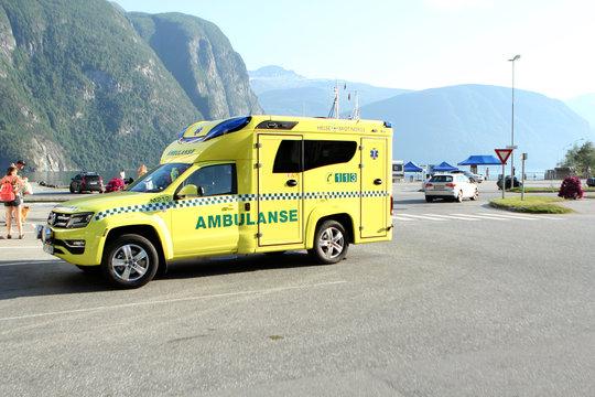 WALLDAL, NORWAY - July 2019: yellow ambulance car in Norway