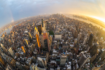 Fototapete - New York City skyline with Manhattan skyscrapers at dramatic stormy sunset, USA. Fish eye wide angle view.
