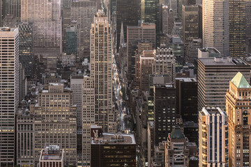 Fototapete - Aerial view of New York City skyline with 5th Avenue at Manhattan midtown. Urban skyscrapers at dramatic after the storm sunset, USA.