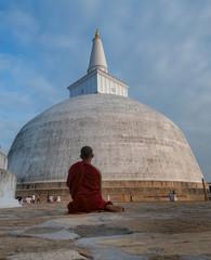 Buddhist Monk Meditating at a Stupa, Anuradhapura, Sri Lanka