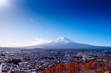 Snow covered Mount Fuji and blue sky autumn view from Chureito Pagoda park in Shimoyoshida - Fujiyoshida