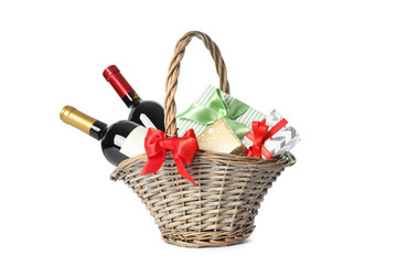 Wicker basket with bottles of wine and presents isolated on white background