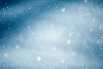 Blue shiny sky with realistic snowflakes. Happy Christmas and New Year copy space background.