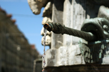 One of the fountains in the street Kramgasse in the ancient center in Bern, Switzerland