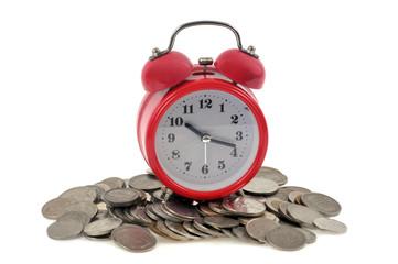 Réveil matin sur des pièces de monnaie