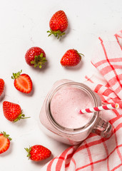 Strawberry milkshake or smoothie in mason jar.