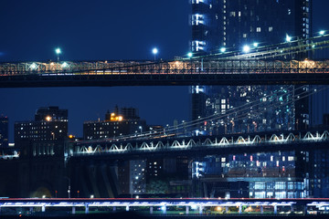 Fototapete - Tiers of bridges over the bay and night skyscrapers. New York. night photo. USA.