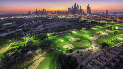Dubai Marina skyscrapers and golf course day to night timelapse, Dubai, United Arab Emirates Fototapete