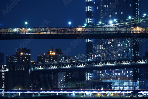 Poster Tiers of bridges over the bay and night skyscrapers. New York. night photo. USA.