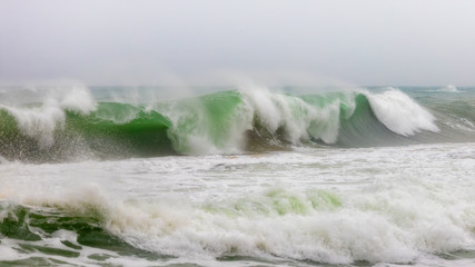 Big waves in Costa Brava coastal in a cloudy day