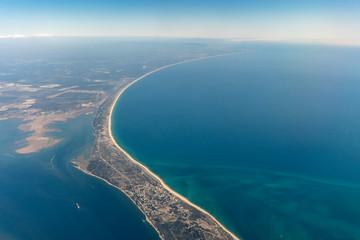 Aerial view of peninsula between Ria Formosa and Atlantic Ocean in Portugal