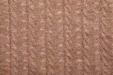 Brown cable knitting fabric textured background