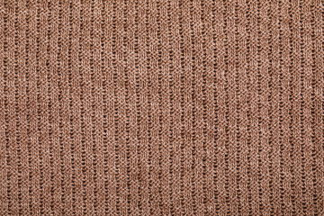 Brown knitting fabric textured background