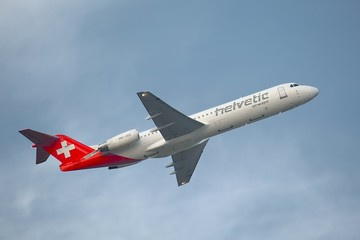 BUDAPEST, HUNGARY - OCTOBER 4, 2014: Airliner of Helvetic Airways is departing from Budapest, October 4th 2014.