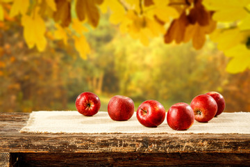 Autumn photo of apples on desk and free space for your decoration.