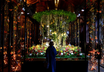 "A visitor watches a floral decoration inside of the Brussels' city hall during ""Flowertime"" event"