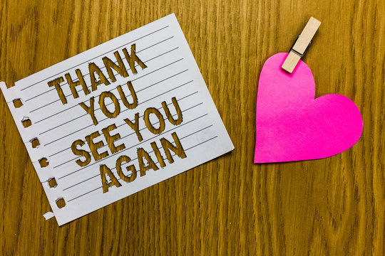 Conceptual hand writing showing Thank You See You Again. Business photo showcasing Appreciation Gratitude Thanks I will be back soon Yellow woody deck word with white page paper clip grip heart