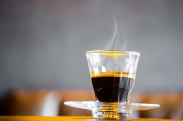 A cup of hot coffee in coffee shop.
