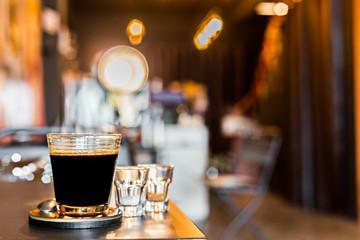 Hot americano coffee in coffee shop.