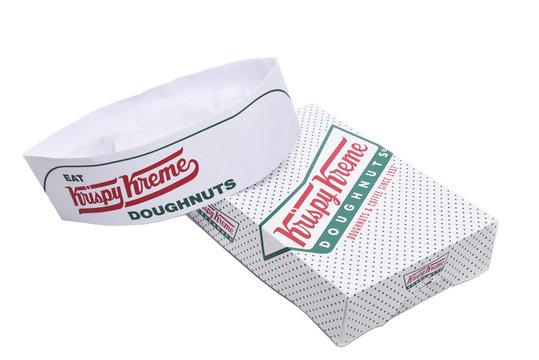 IRVINE, CALIFORNIA - JANUARY 24, 2016:  Krispy Kreme Doughnut Boxand hat. Krispy Kreme Doughnuts is a global doughnut company and coffeehouse chain.