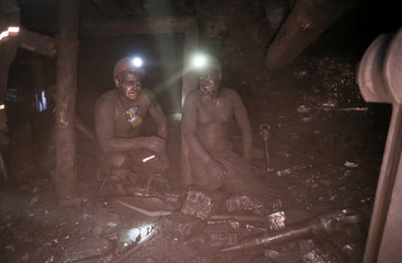 Employees work at a coal mine in Torez