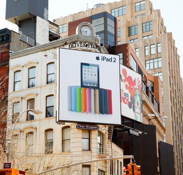 New York, New York, USA - March 27, 2011: An Apple iPad 2 billboard on the corner of a building in the Soho area of Manhattan as seen in the late afternoon.