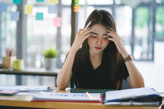 Confused business woman with stressed and worried about  working mistake and problems.