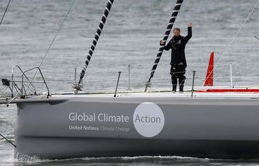 Swedish teenage climate activist Greta Thunberg waves from a yacht as she starts her trans-Atlantic boat trip to New York, in Plymouth