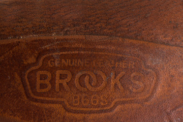 Detail of the vintage Brooks England bicycle saddle. Brooks England is a bicycle saddle manufacturer founded at 1866 in Birmingham.