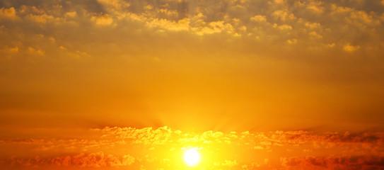 Beautiful sunrise and cloudy sky. Wide photo .