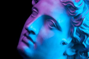 Papiers peints Magasin de musique Gypsum copy of ancient statue Apollo head isolated on black background. Plaster sculpture man face.
