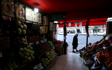 A costumer shops at a greengrocery in Buenos Aires