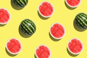 Pattern with ripe watermelon on yellow background. Pop art design, creative summer concept