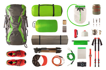 Top view of sport equipment and gear for trekking and camping. Collection of cookware, sleeping...