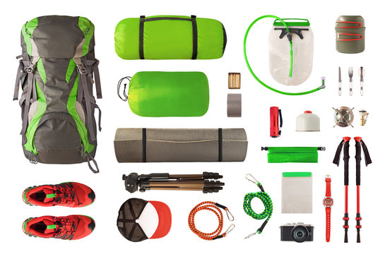 Top view of sport equipment and gear for trekking and camping. Collection of cookware, sleeping bag, travel accessories, etc. isolated on white background