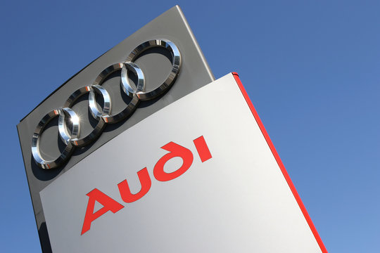 GUMMERSBACH, GERMANY - August 27, 2016: Audi dealership sign against blue sky. Audi is a German automobile manufacturer and part of the Group.
