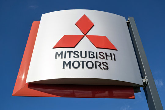 LEIDERDORP, THE NETHERLANDS - June 19, 2018: Mitsubishi dealership sign against blue sky. Mitsubishi  Motors is a Japanese multinational automotive manufacturer headquartered in Minato, Tokyo, Japan.