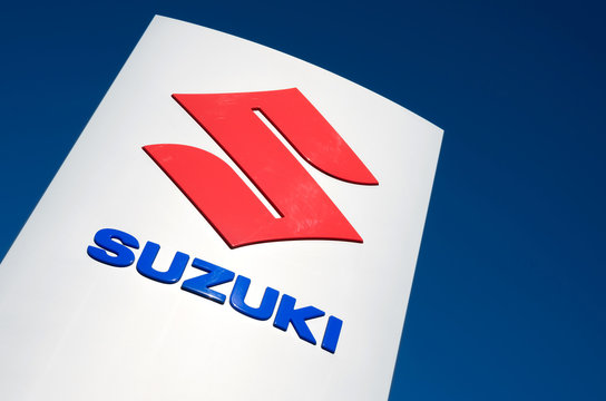 WIEHL, GERMANY - August 27, 2016: Suzuki dealership sign against blue sky. Suzuki is a Japanese multinational corporation and produces automobiles and motorcycles among others.