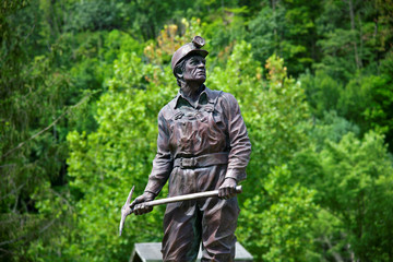 A statue of a coal miner sits at the center of the Coal Miners Memorial Park in Lynch