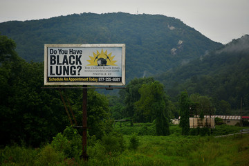 A billboard targeted at coal miners suffering from Black Lung on the highway outside Pineville