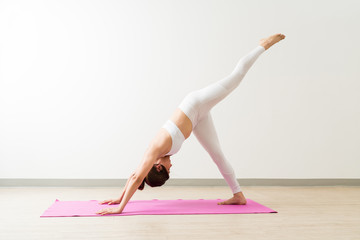 Woman In Sportswear Exercising At Yoga Studio