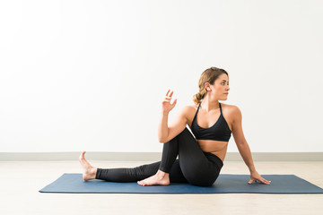 Attractive Confident Young Female Doing Ardha Matsyendrasana